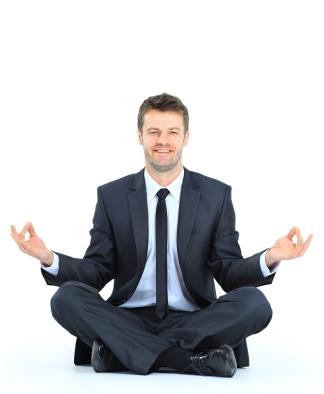 Businessman meditating in yoga lotus pose on floor