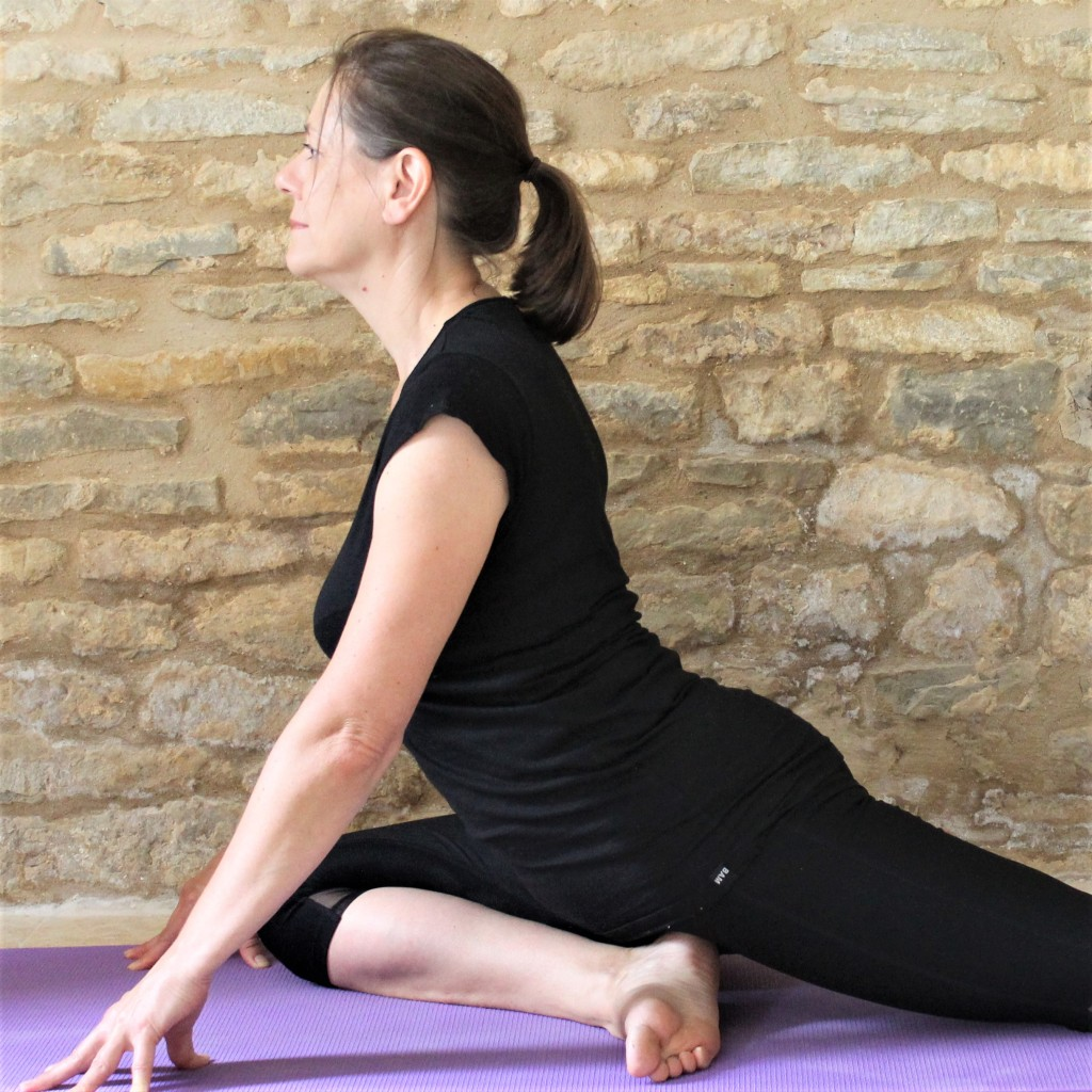 Yoga Teacher Deborah King demonstrates pigeon pose