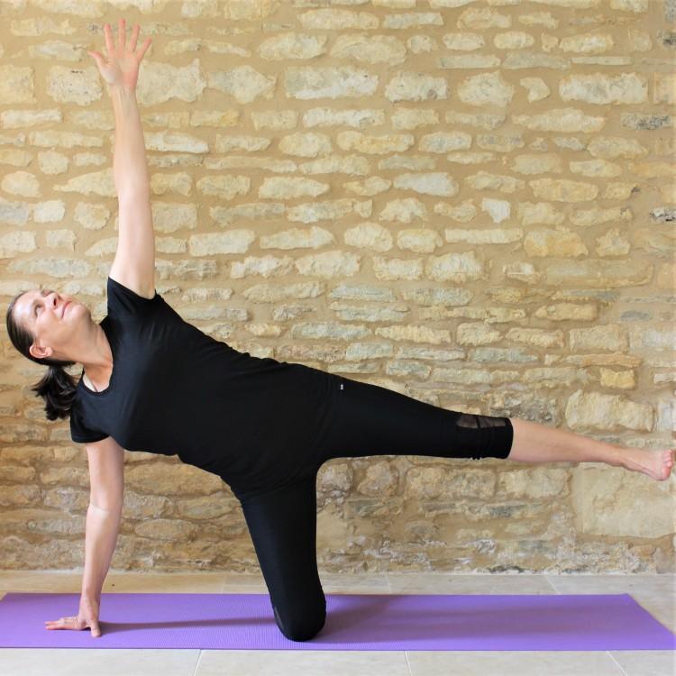 Yoga Teacher Deborah King demonstrates Half Moon pose