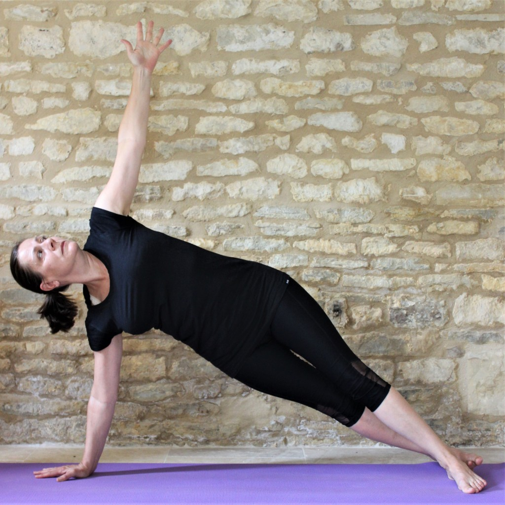 Yoga Teacher Deborah King demonstrating side plank pose