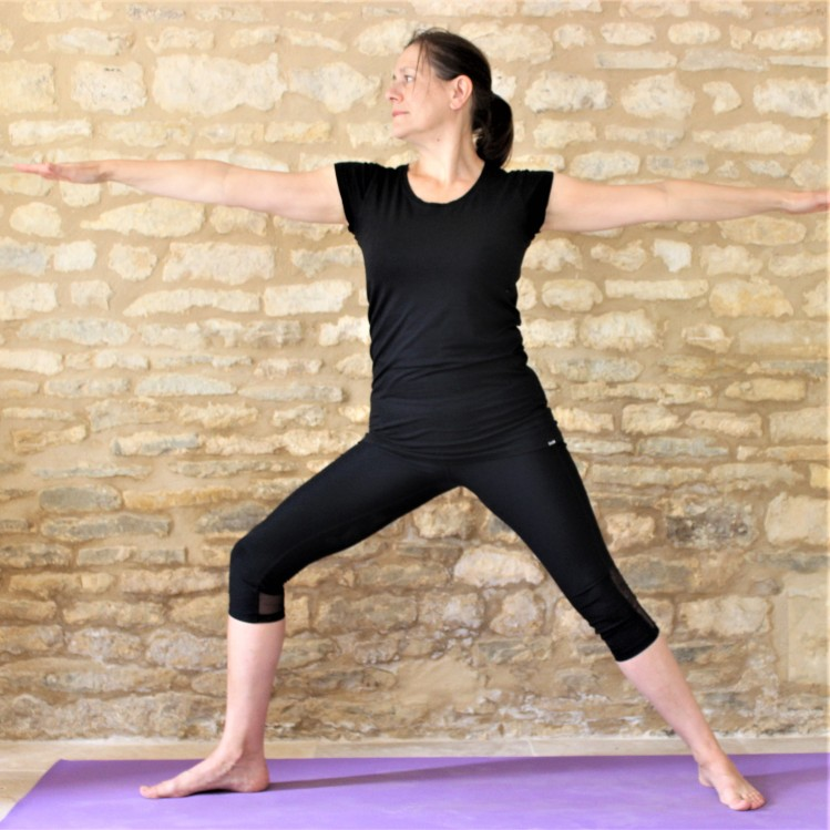 Yoga Teacher Deborah Kinga demonstrates Warrior 2 pose
