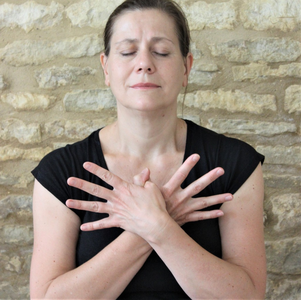 Yoga Teacher Deborah King meditating with Garuda mudra