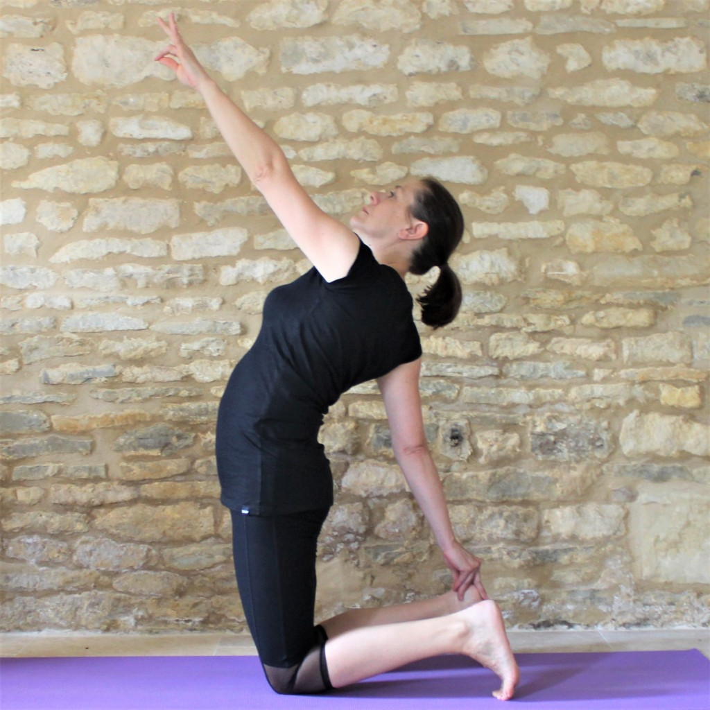 Yoga Teacher Deborah King demonstrating half camel pose