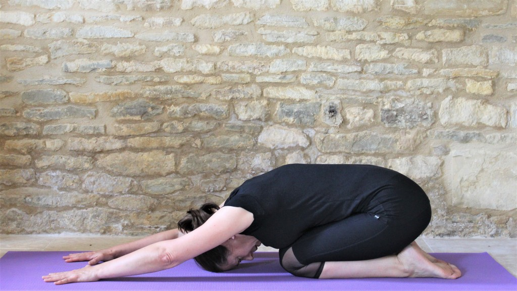 yoga teacher Deborah King demonstrates childs pose