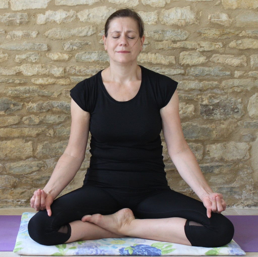 Yoga Teacher Deborah King in a meditation posture
