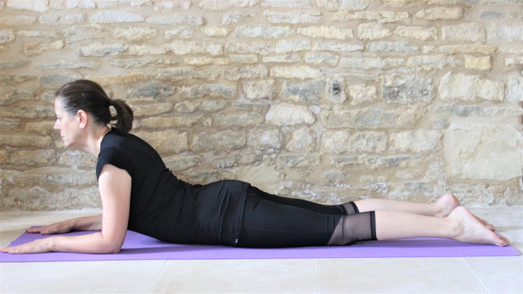 Yoga Teacher Deborah King demonstrating sphinx pose